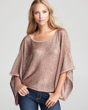 Looks easy to sew! I would make a more casual version perhaps by using a t-shirt or some knit material. I adore the draping/slouchy look of the top. I think a dress version would also be interesting and neat. (Batwing Silver Sequin Sweater)