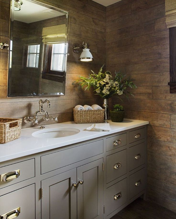 Wood accents in elegant bathroom with green accessories | Alexandra Rae Design
