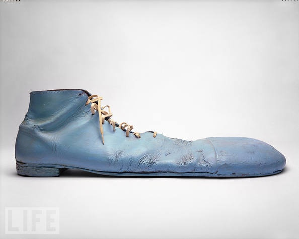 Bozo the Clown: Oversized Clown Shoes, 1960 - 1984          Bozo's big blue shoes were worn by Bob Bell, the original actor to portray Bozo for Chicago's WGN-TV, for nearly 25 years. The WGN version of Bozo also aired nationally on cable and satellite from 1978 to 2001 and became the most well-known of all the Bozo shows. WGN's Bozo's Circus is recognized as the most popular locally produced children's show in history. Bozo is a trademark and copyright of Larry Harmon Pictures Corp…