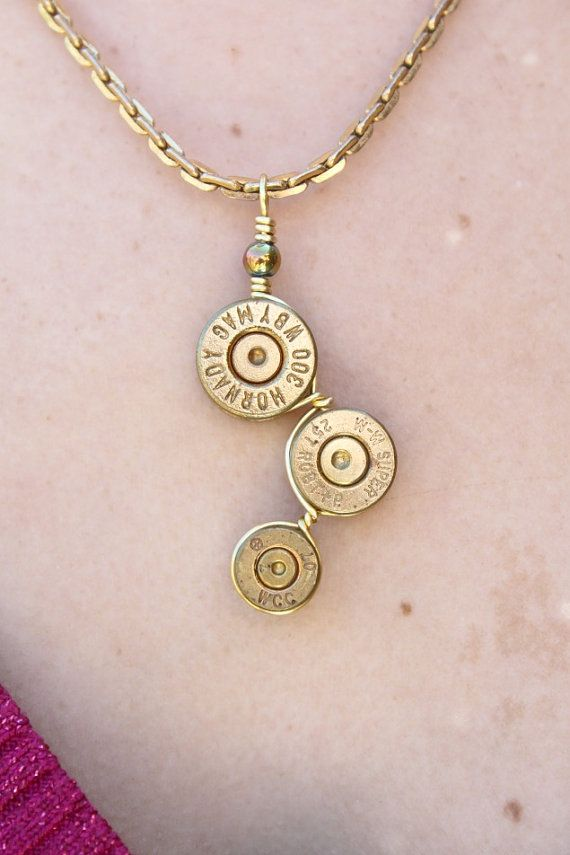 One of my favs! Side to Side design with various shell endings, original shot primers left for a more rustic trend. ~ Bullet Casing Caliber End Necklace Brass by IndustrialFlareByEve, $35.00