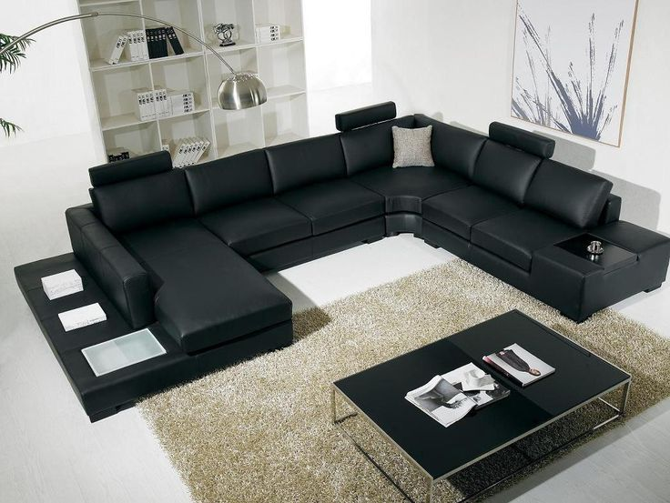 Exotic Gothic Leather Couch In Living Room Designing  With Black Table On The Chair Beige Fur Rug As Well Book Shelves In The Near Wonderful Living Room Designing for Comfortable living Space living room