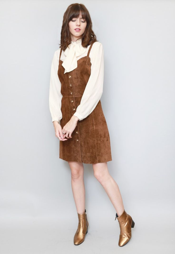 """Vintage 1970s Sam Choice Brown Suede Mini Button Front Dress. Gorgeous chocolate brown suede button front mini dress. Features a soft panelled suede. Size UK 14 approx. Our model is a size 8. Please see sizing for measurements. If you love Peekaboo Vintage, """"follow"""" us here on ASOS. First-time buyers will receive a discount code and you will also be kept up-to-date with our daily arrivals. Our hassle-free returns means you can shop with ease. Lots of Love Peekaboo xx"""