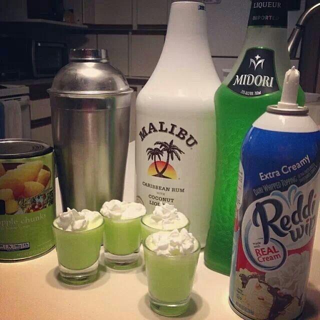 Scooby Snacks shots. 1/2 oz. Midori 1/2 oz. Malibu coconut rum Splash of pineapple juice Splash of whip cream Blend and top with whip cream.