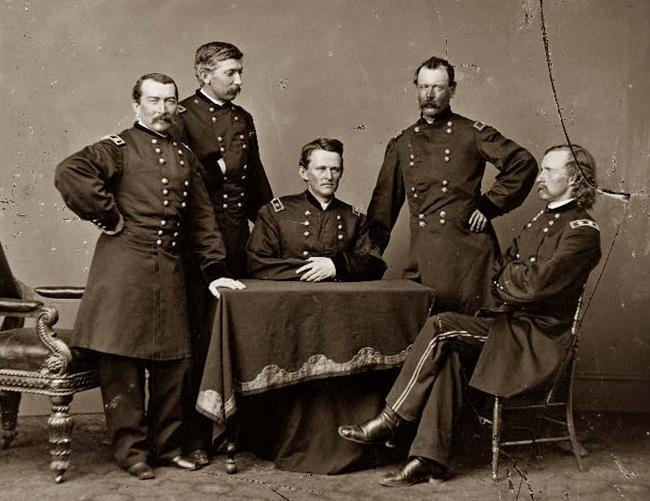 General Philip Sheridan and his staff. On the extreme right sits General George Armstrong Custer.