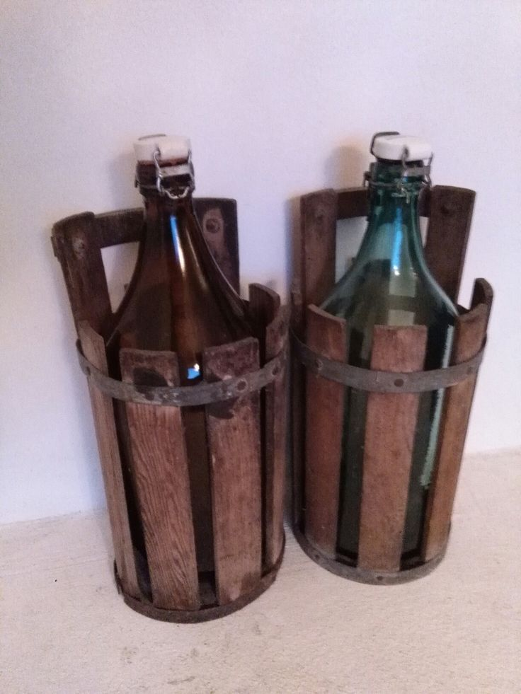Two glass bottles (5 l.) in their original «baskets». The names of the brewery and brewmaster/owner are written on both porcelain lids. They are from a brewery in Breum in Denmark (Breum Bryghus, closed in 1971). Søren Chr. Sørensen was the owner from 1918-1959. #glass #bottles #brewery #Breum #bryghus #Denmark #beer #vintage #old