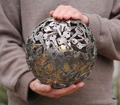 garden art sphere made of keys. If I had kept all my old apartment and house keys, this could become personalized.