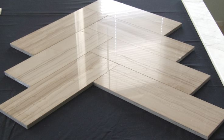 This is natural stone. It is designed in the form of wood. This wood stone laminated with ceramic. Made of Lamina Stone