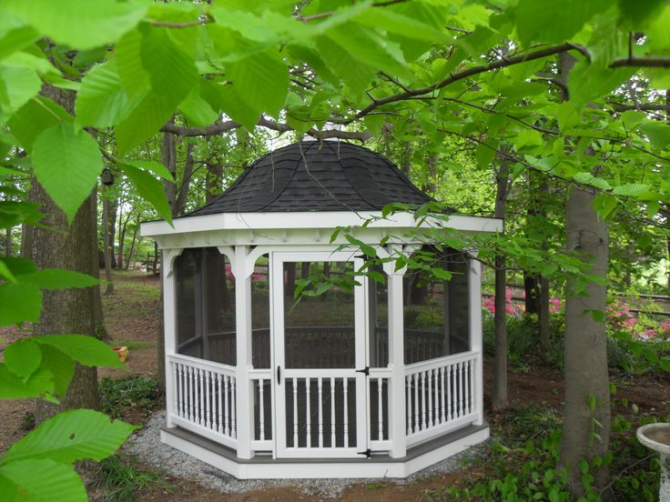 backwood octagon gazebo with a bell top roof with black asphalt shingles this is a - Screened Gazebo