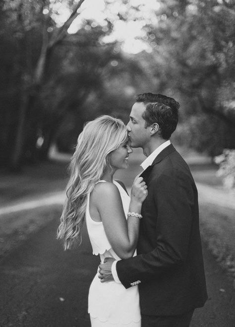 There's nothing more romantic than a loving kiss on the forehead. Check out those 8 Cutest Engagement Photo Ideas. http://www.colincowieweddings.com/articles/engagements-celebrations/the-8-cutest-engagement-photo-ideas #EngagementPhoto #CouplePhoto
