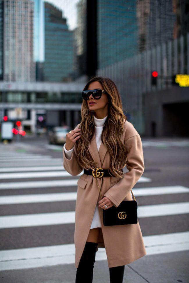 Gucci belt over camel coat