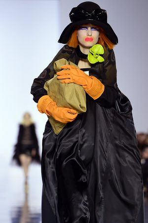 Models in neon makeup creeping along the catwalk carrying a paper bag or wearing a pinstripe bustier had all the hallmarks of John Galliano.@tshirtzoon