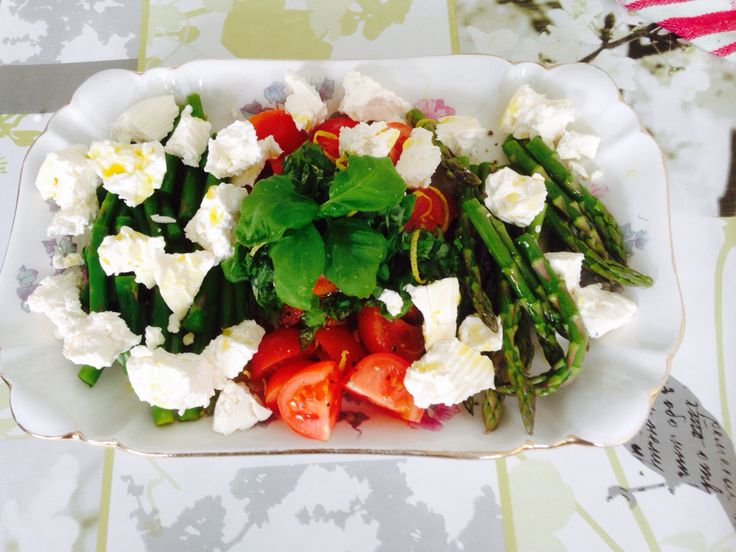 Feta cheese salad with tomato, basil , asparagus olive oil and lime zest