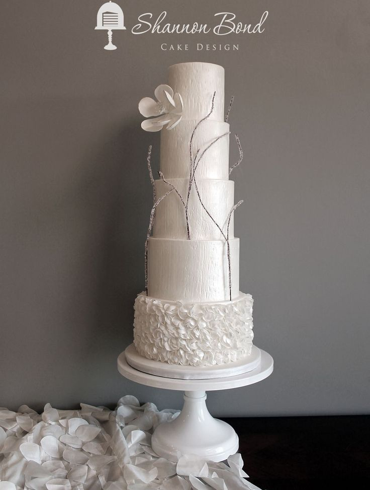 Winter's Love Wedding Cake  Winter's Love Wedding Cake Marsala colored sugared twigs, textured fondant, petal ruffles and gumpaste flower tipped in gold  #branch #twigs #fall #cakecentral