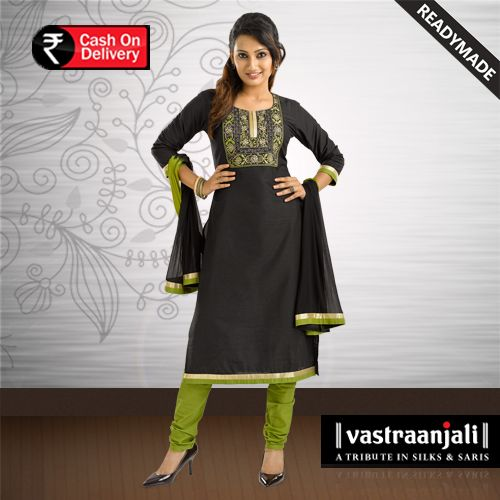 Black long- slub kurta has a round neckline with a square embroidered yoke. Green and golden taping on the hemline of the kurta has three quarter sleeves. Green woven churidhar bottom with drawsting tapered legs. The 2 toned dupatta has taping on its borders.  For more details and online shopping Visit www.vastraanjali.com
