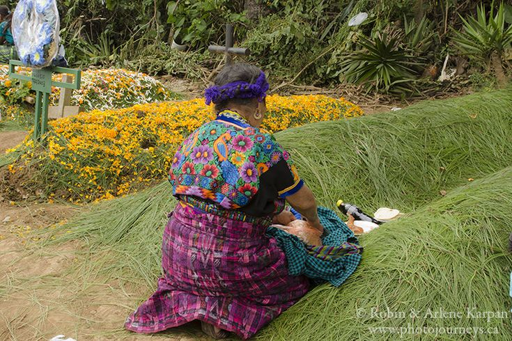 A woman tends the grave of a loved one on All Saints Day, November 1, Sumpongo, Guatemala - Photo Journeys