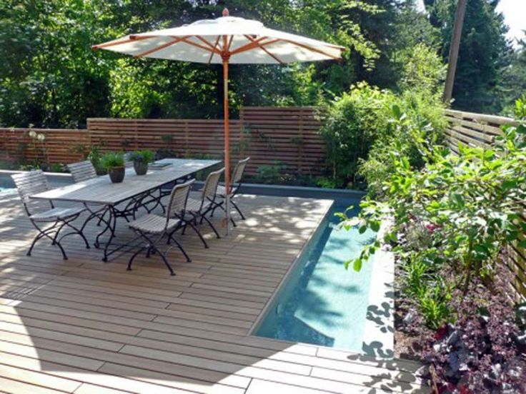 Floating Outdoor Dining Room Design With Umbrella And Wooden Floor Lanewstalk