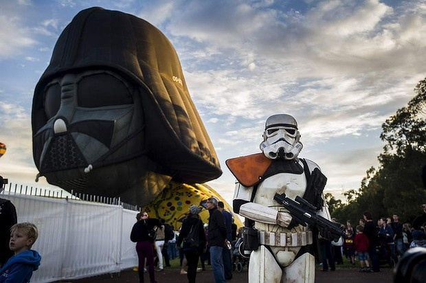 A 300-kilogram Darth Vader head floats over Canberra. It must be the start of the Balloon Spectacular.