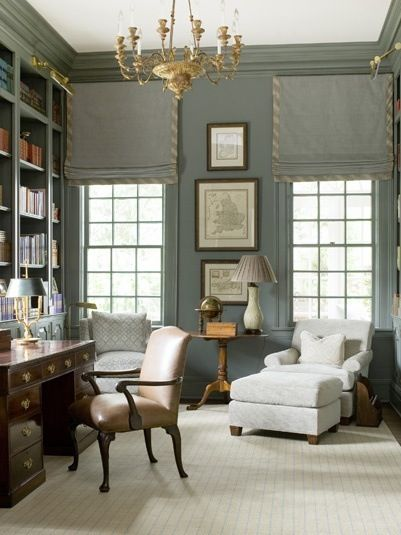 Notice how a couple of gold items help make a bland gray room pop to the eye.