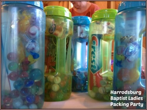 Waterbottle packing. Each one contains marbles, candy, toothpaste, toothbrush, pencils, sharpener, and a comb. Use every bit of space!