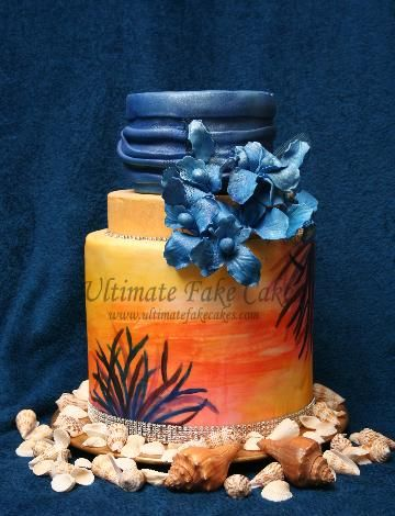 3 tier fondant sunset and orchids cake.