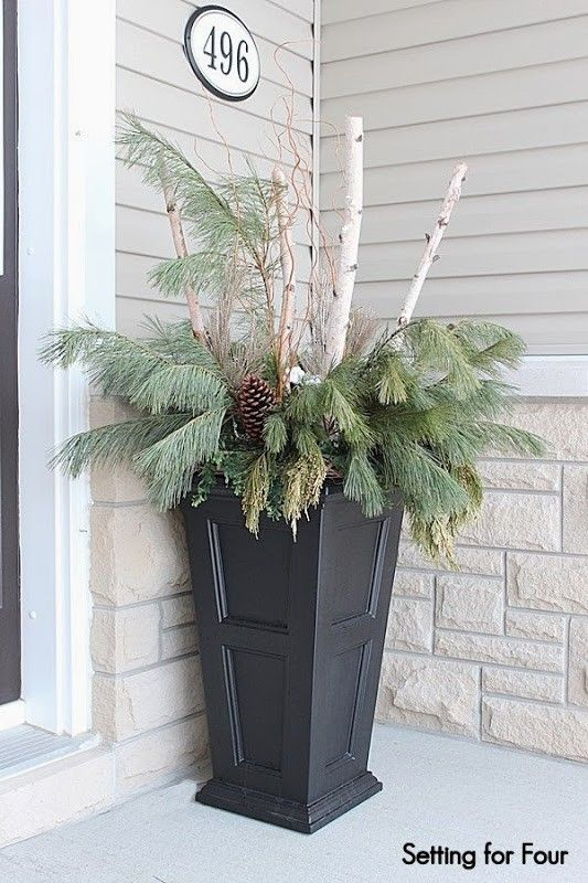 Urn decor with birch branches,curly willow, fresh pine and large pinecones