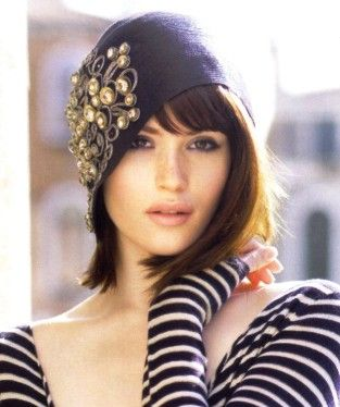 She's just beautiful... but I do love wide necklines and looong sleeves. Oh ya, and cloche hats.