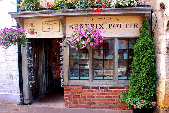 """Beatrix Potter storefront, Gloucester. The store is built in the image of Beatrix Potter's """"The Tailor of Gloucester"""" book illustration."""