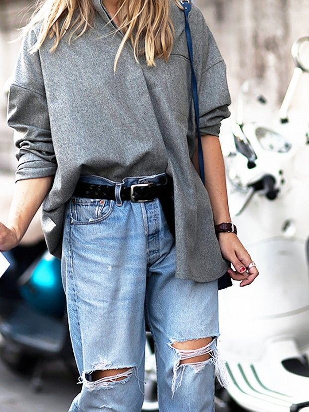 Ripped knee jeans, oversized shirt, tomboy style