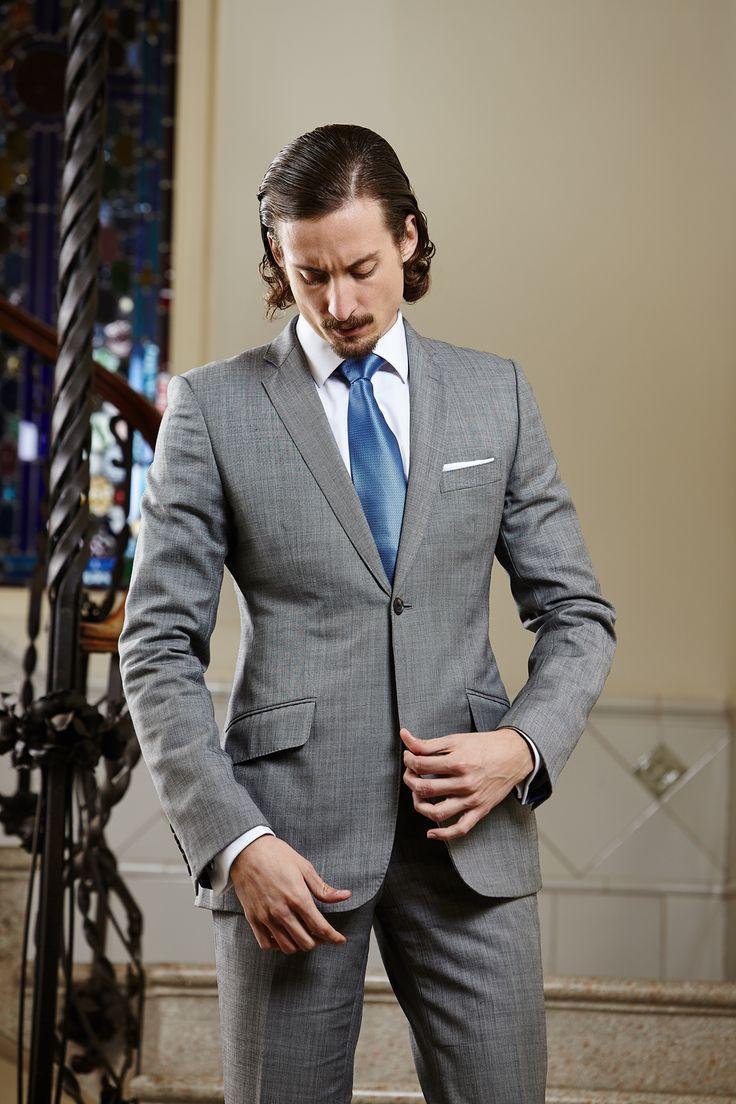 Men's light grey two-piece tailored suit.