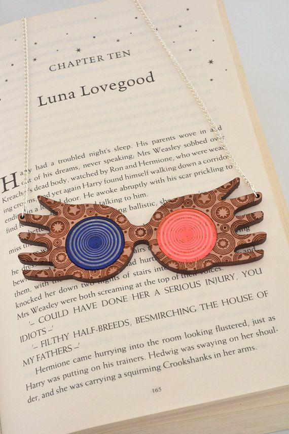 We love Luna Lovegood from the Harry Potter series, so we stole her glasses and turned them into a necklace ! An irregular necklace for every magic personnalities !  ● Description ●  This is a handcrafted original design, inspired by the strange but lovely Luna Lovegood from Harry Potter. Its laser cut and engraved on quality cherry wood and translucent acrylic.  ● Details ●  • The pendant is 3,9 inch (10 cm) wide, 1,4 inch (3,5 cm) tall and 0,16 inch (4 mm) thick. • The chain is 8,7inch…