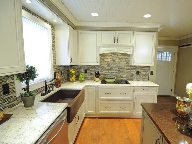 White kitchen, tile backsplash, light colored granite