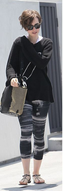 Who made Lily Collins' sunglasses, safety pin sweater, and black studded handbag?