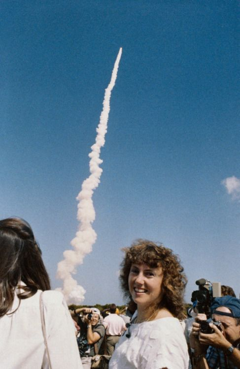 October 30, 1985 – Christa McAuliffe watches the Space Shuttle Challenger  blast off from NASA's Kennedy Space Center in Florida. A few months later, she would perish on the very same shuttle in the Challenger disaster of 1986.