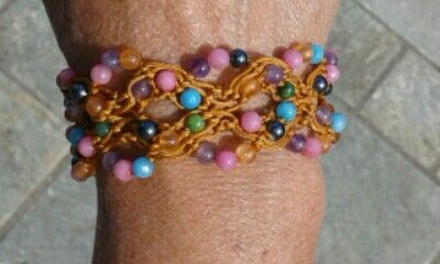 Beaded fall bracelet with ruby , turquoise , coral and jade semi-precious stones .