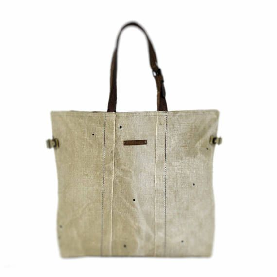 Large tote bag, shopping bag, recycled  • Handmade product • Material: drawn, old military lorry canvas • Size: 53cm/20.9 width, 40cm/15.7 height, 12cm/4.7 depth • Inside there is 1 big pocket with zip and 1 pocket which falls into 3 parts • Its lining is strong canvas • The straps': 57cm/22.4 (singly) • It can be closed with magnetic clasp   In this shop you can find handmade, unique products. I reuse old military truck canvas, dufflebags, and various bags as materials. I select and clean…