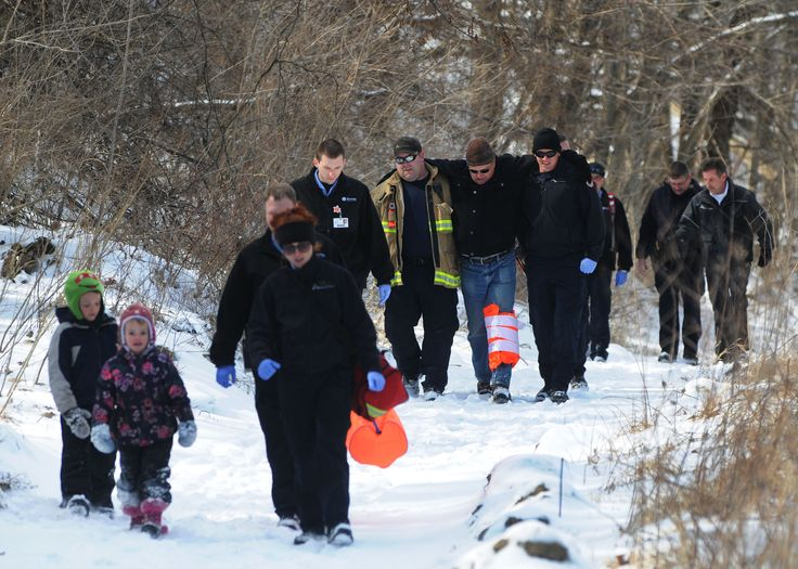 Ames firefighters, paramedics from Mary Greeley Medical Center, and Ames police officers rescue a man and his grandchildren who were hiking Skunk River Trail in Ames. Police said the man called 911 after falling down and injuring his knee Tuesday, March 14, 2017, in Ames, Iowa. The name of the injured man wasn't immediately available Tuesday. Photo by Nirmalendu Majumdar/Ames Tribune