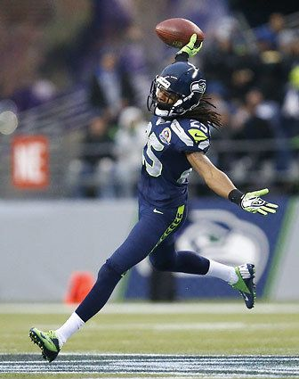 Seattle Seahawks cornerback Richard Sherman celebrates an interception against the Arizona Cardinals offense in December. Seattle crushed the Cardinals, 58-0.
