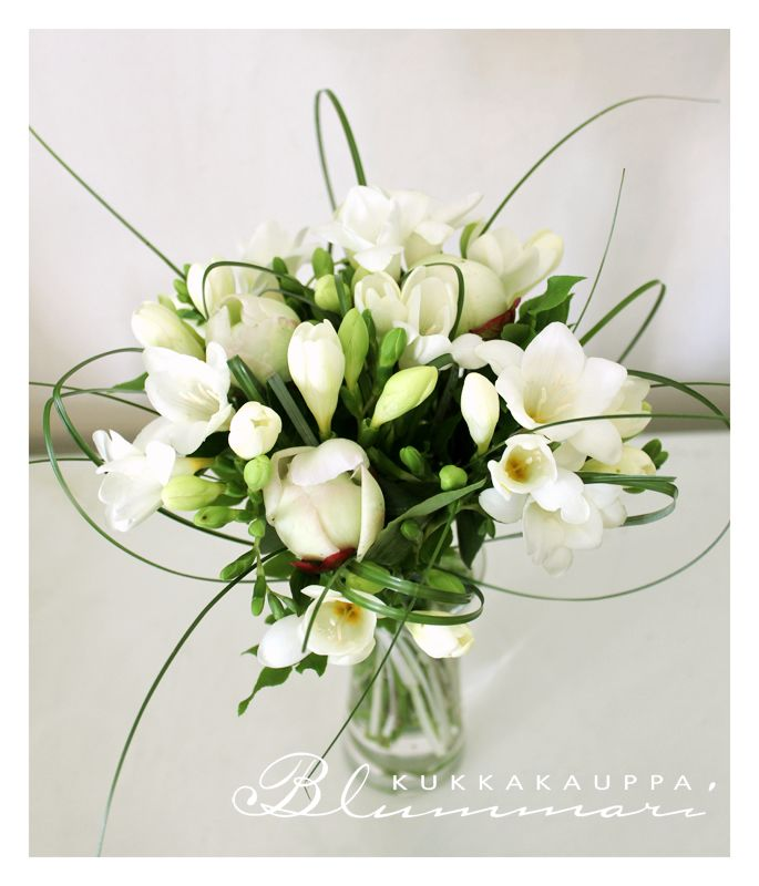 Light wedding bouquet from freesia and peony.