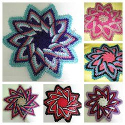Colorful Kitchen Trivet  Use whatever colors you have lying around to make yourself a Colorful Kitchen Trivet. This crochet pattern is an excellent stashbuster project. The instructions include a few different variations for crocheting the center.
