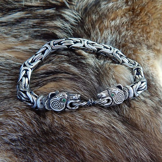 Attention! If the options dont have your Wrist size, write it in the order comments!  Animal heads - its a clasp (the lower jaw is movable). Diameter Ø: 8 mm. Size of bracelet.: we can make it any circle. Weight of bracelet approximate: 65 gramms. Material: .925 Sterling silver. Two versions - with stones in the eyes and without them. Choice of stones for eyes: garnet (red), Topaz (blue), Cubic Zirconia (green). Production: Hand Made  Unique and beautiful sterling silver hand forged and…