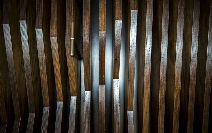 Dokk1 | Door fitted with custom hinges and wooden slats. #vahledoor #dokk1 #architecture #architectural #wood #door #woodworking #wooddoor