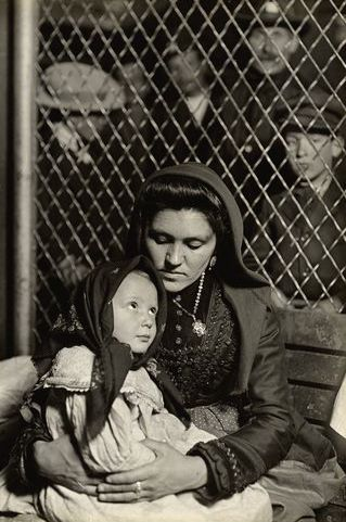 Early Pictures: Immigrant Italian mother and child, Ellis Island, New York, Lewis Hine 1905