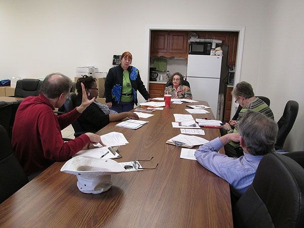 ACWC members participate in a writing exercise at a monthly meeting.