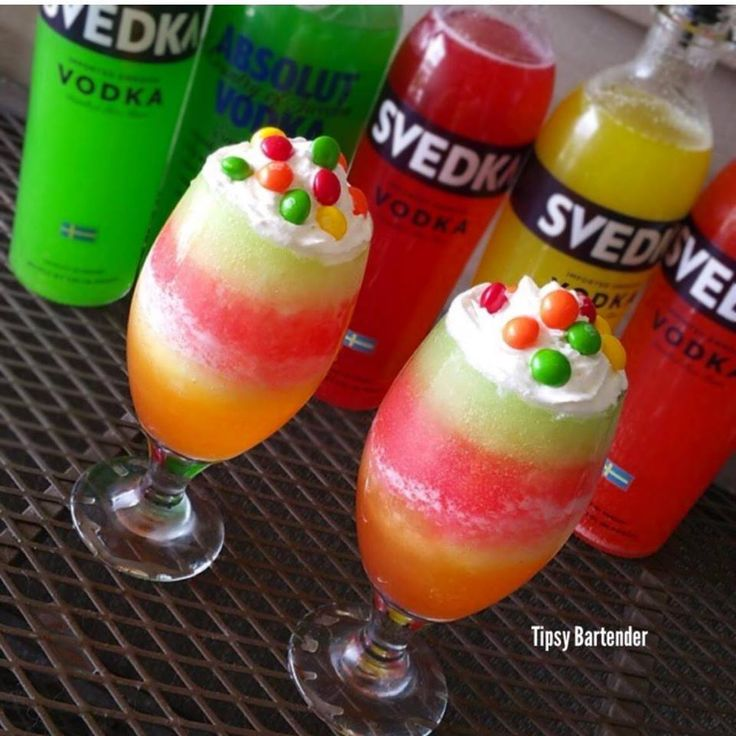 Slutty Skittle Shots - For more delicious recipes and drinks, visit us here: www.tipsybartender.com