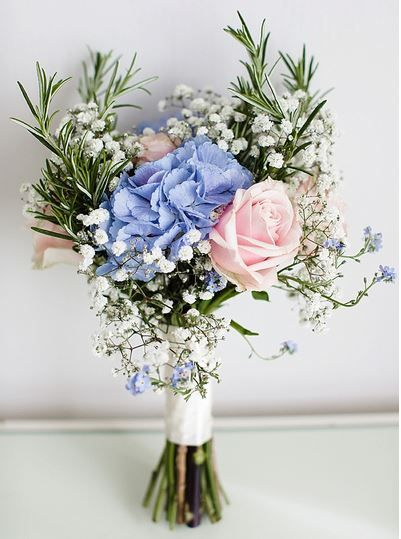 Rockmywedding / Rose, Hydrangea, Gypsophelia, Rosemary and Forget-Me-Not bouquet at a pretty pastel wedding.