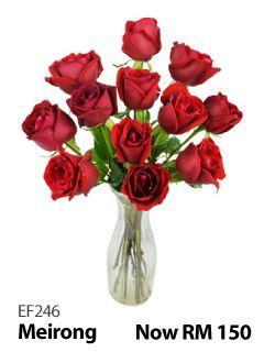 12 red roses in a glass vase.