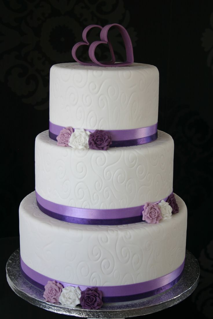 simple and elegant -- with a touch of purple. the topper goes with the theme (and is a budget-friendly solution)