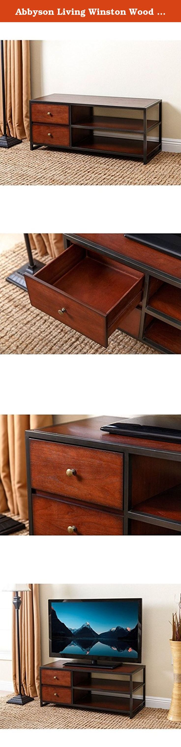 Abbyson Living Winston Wood 42-inch TV Stand. Sure to enhance any living room or entertainment space, the Abbyson Living Winston Small TV Stand features durable wood construction. It fits most TVs up to 46 inches. This TV stand is finished in coffee brown with black trim for contrast. Two drawers and two shelves provide storage space for media components. About Abbyson Based in California, Abbyson has been America's leading home lifestyle furnishings brand since 1989. Following a mission...
