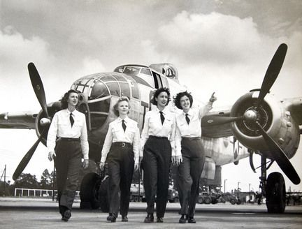 Dorothy Dodd Eppstein, Hellen Skjersaa Hansen, Doris Burmester Nathan and Elizabeth Chadwick Dressler, walk in front of a B-25 plane, as they were Air Force engineering test pilots for the B-25 during World War II