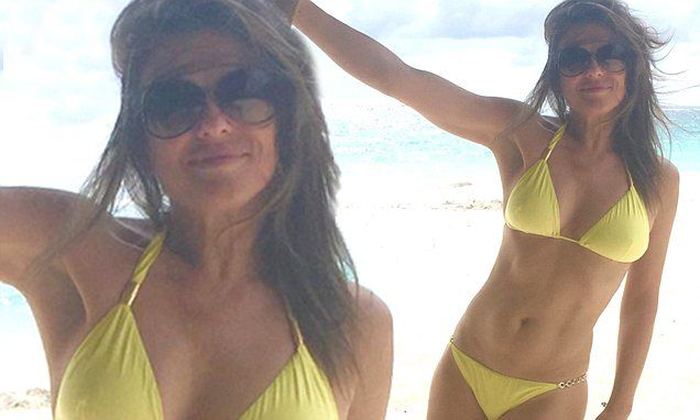 Elizabeth Hurley, 50, looks youthful in skimpy yellow bikini
